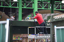 © Licensed to London News Pictures. 12/06/2017. London, UK. A man cleans the top of a stall in Borough Market as traders begin clearing up ahead and prepare to reopen. The market was the scene of a terrorist attack on Saturday 3 June 2017 in which eight people were killed. Photo credit: Rob Pinney/LNP