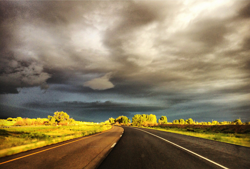Storm clouds gathering in beautiful morning light in Western Colorado along I-70