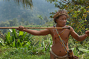 Orang Asli are indigenous people of Malaysia. There are around 18 sub tribes scattered throughout the peninsula of Malaysia. They are culturally isolated and sidelined, and sell native crafts to help them survive. Here a tribesman is eager to have photos taken with him on his native garb and also to demonstrate his blow-pipe -or sunpit- skills of shooting darts.