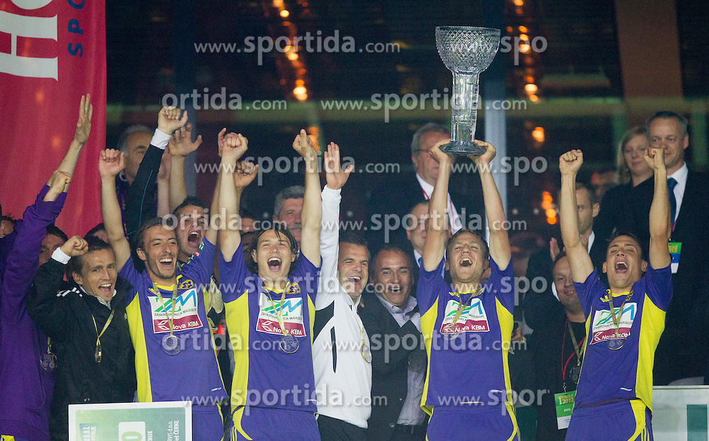 Players of Maribor celebrate at trophy ceremony after the football match between NK Celje and NK Maribor in final of Hervis Cup 2011/12, on May 23, 2012 in SRC Stozice, Ljubljana, Slovenia. Maribor defeated Celje after penalty shots and became Slovenian Cup Champion. (Photo by Vid Ponikvar / Sportida.com)