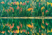Autumn  colors reflected in  Lac Modène. Great Lakes - St.  Lawrence Forest Region.<br />La Mauricie National Park<br />Quebec<br />Canada