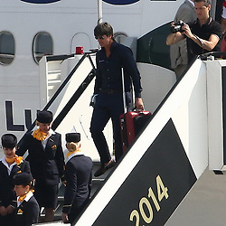 15.07.2014, Flughafen Tegel, Berlin, GER, FIFA WM, Empfang der Weltmeister in Deutschland, Finale, im Bild Bundestrainer Joachim Loew (GER) verlaesst das Flugzeug. // SPO during Celebration of Team Germany for Champion of the FIFA Worldcup Brazil 2014 at the Flughafen Tegel in Berlin, Germany on 2014/07/15. EXPA Pictures © 2014, PhotoCredit: EXPA/ Eibner-Pressefoto/ Hundt<br /> <br /> *****ATTENTION - OUT of GER*****