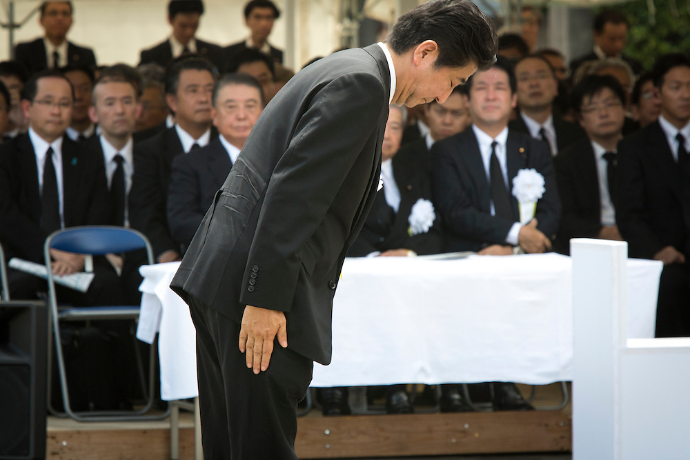 NAGASAKI, JAPAN - AUGUST 9 : Japanese Prime Minister Shinzo Abe bow after address speech during the 71st Anniversary of atomic bombing on Nagasaki at Nagasaki Peace Park, Nagasaki, southern Japan, Tuesday, August 9, 2016. Japan marked the 71st anniversary of the atomic bombing on Nagasaki. On August 9, 1945, during World War II, the United States dropped the second Atomic bomb on Nagasaki city, killing an estimated 40,000 people which ended World War II. (Photo by Richard Atrero de Guzman/NURPhoto)