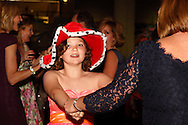 Cancer warrior Kayleigh Crabtree, 11 of Beavercreek  wears one of This Side Up's traditional fun hats on the dance floor during CHA-CHA 2013, benefiting Dayton Children's Medical Center, held at Sinclair Community College's Ponitz Center, Saturday, May 11, 2013.