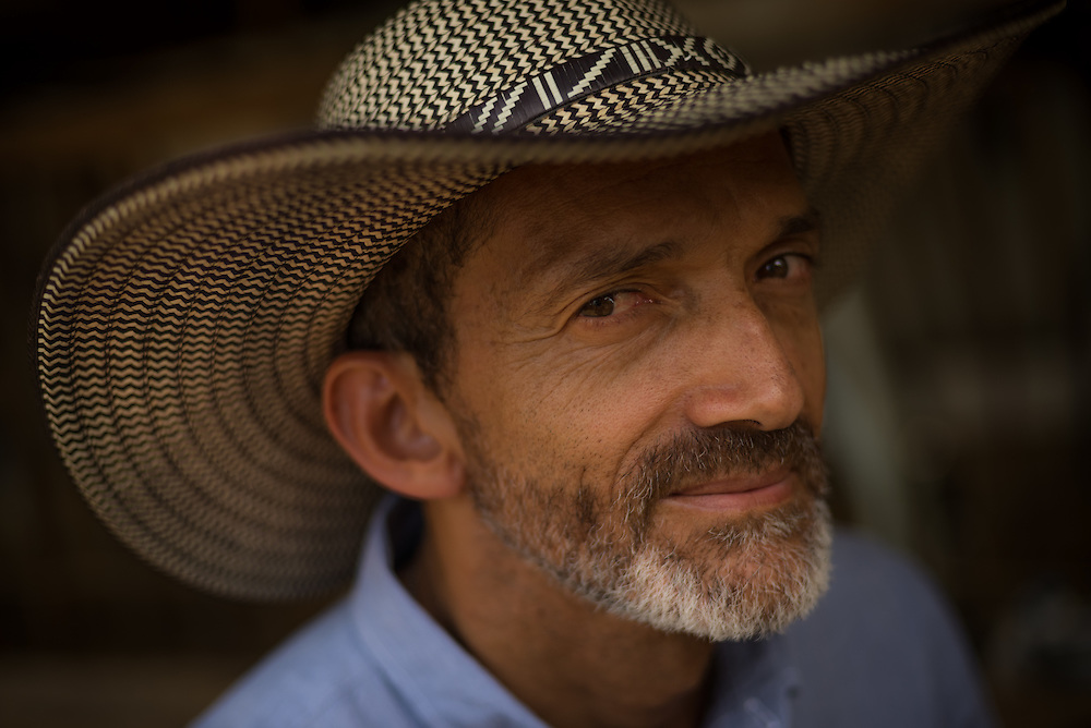 LA LUISA, COLOMBIA - AUGUST 16, 2014: Julian Chara, research director at CIPAV, poses for a portrait at Petique dairy farm, a model of silvopastoral systems in Colombia.  Chara has worked tirelessly to educate ranchers about silvopastoral systems in effort to implement sustainable practices at cattle farms across Colombia. PHOTO:  Meridith Kohut/Shoot the Earth for World Animal Protection