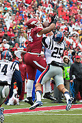 FAYETTEVILLE, AR - NOVEMBER 22:  Hunter Henry #84  of the Arkansas Razorbacks goes up for a pass but has it knocked away by Cody Prewitt #25 of the Ole Miss Rebels at Razorback Stadium on November 22, 2014 in Fayetteville, Arkansas.  (Photo by Wesley Hitt/Getty Images) *** Local Caption *** Hunter Henry; Cody Prewitt