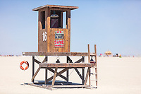 The Tower<br /> by: ART BARF<br /> from: Seattle, WA<br /> year: 2019<br /> <br /> The Tower is an interactive lifeguard stand and observation deck accessible by ladder. Visitors can climb up to the deck and observe the playa from a new vantage. Inside the hut, visitors find simple tools for spontaneous interaction. Made of untreated wood, the simple shape looks both silly and at home on the waterless beach. Named for card 16 in the tarot's major arcana, where The Tower represents the chaos of sudden change.<br /> <br /> https://burningman.org/event/brc/2019-art-installations/?yyyy=&artType=B#a2I0V000001T9sTUAS