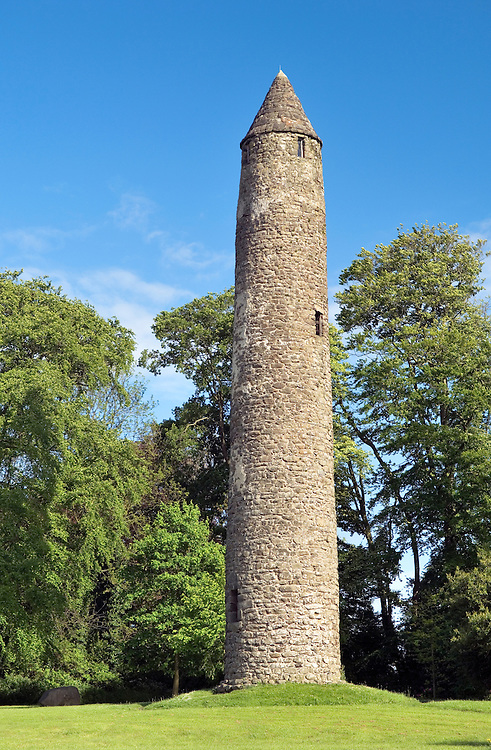 Well preserved ancient Celtic Christian monastic round tower in the town of Antrim, County Antrim, Northern Ireland.