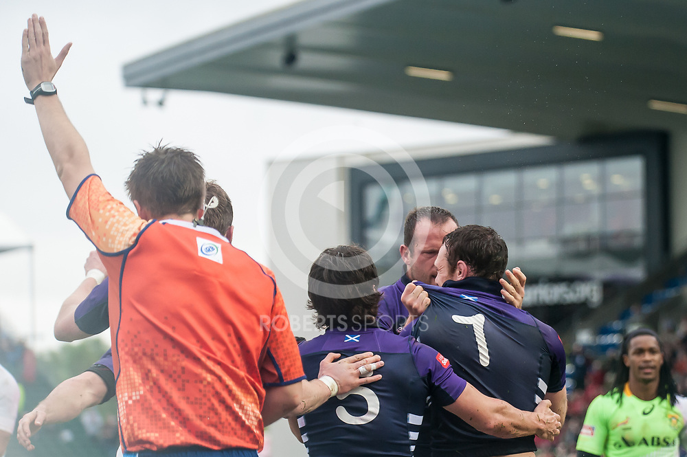 Scotland players celebrate their winning try against South Africa in the quarter final game at the IRB Emirates Airline Glasgow 7s at Scotstoun in Glasgow. 4 May 2014. (c) Paul J Roberts / Sportpix.org.uk
