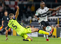 Football - 2018 / 2019 EFL Carabao Cup (League) Cup - Fulham vs. Exeter City<br /> <br /> Aaron Martin (Exeter FC) slides in to tackle Neeskens Kebano (Fulham FC) at Craven Cottage.<br /> <br /> COLORSPORT/DANIEL BEARHAM