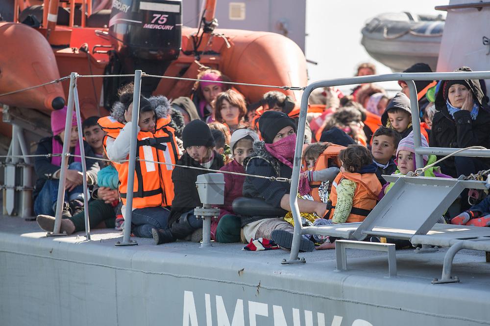Mytilene, Lesvos, Greece - 07.03.2016      <br /> <br /> The Greek coast guard brings refugees into the port of Mytilene. They pick them up in the sea between Turkey and the Aegean island Lesbos.<br /> <br /> Die griechische Kuestenwache bringt Fluechtlinge in den Hafen von Mytilini. Sie nahmen sie im Meer zwischen der Tuerkei und Lesbos an Bord. <br /> <br /> Foto: Bjoern Kietzmann