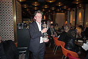 JOHN HURT WITH HIS LIBERATUM AWARD, Liberatum Cultural Honour  for John Hurt, CBE in association with artist Svetlana K-Lié.  Spice Market, W London - Leicester Square