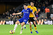 Chelsea defender Andreas Christensen beats Wolverhampton Wanderers forward Raul Jimenez (9) to the ball during the Premier League match between Wolverhampton Wanderers and Chelsea at Molineux, Wolverhampton, England on 5 December 2018.