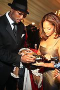 l to r: Alonzo Mourning and Tracey Mourning at the The Radio One Inaugural Celebration 2009 Hennessey VIP Lounge Salute held at Lincoln Theater in Washington, DC on January 17, 2009..CATHY HUGHES, RADIO ONE FOUNDER AND CHAIRPERSON had a Hometown Inaugural Salute to President Barack Obama and Tom Joyner at the Lincoln Theater in Washington DC. Hennessy hosted celebrities and guests in a branded Hennessy lounge where Tatiana Ali interviewed celebrities about their feelings toward the Barack Obama Presidency. Celebrities in attendance included Jamie Foxx, Alonzo Morning, Eddie Levert, T. D. Jakes, Rev. Al Sharpton, Jackie Reid, Roland Martin, Dick Gregory, Raheem DaVaughn, Bow Bow, and more. Hennessy presented a commemorative Hennessy 44 Bottle which was signed by numerous celebrities which will be auctioned to create 4 four-year scholarships via the Thrugood Marshall College Fund...