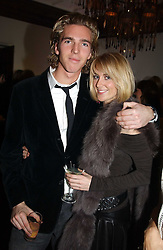 LADY EMILY COMPTON and MR JAMES COOK at a party to celebrate the 4th anniversary of Quintessentially held at 11 Grosvenor Place, London  SW1 on 14th December 2004.<br /><br />NON EXCLUSIVE - WORLD RIGHTS