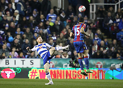 Paul McShane of Reading is beaten to the ball by Mile Jedinak of Crystal Palace - Mandatory byline: Robbie Stephenson/JMP - 11/03/2016 - FOOTBALL - Madejski Stadium - Reading, England - Reading v Crystal Palace - Emirates FA Cup Quarter Final