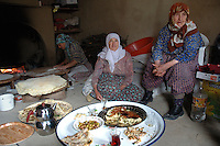 Family of different generations having meal in small rural village of Eymir in Anatolia Southern Turkey.