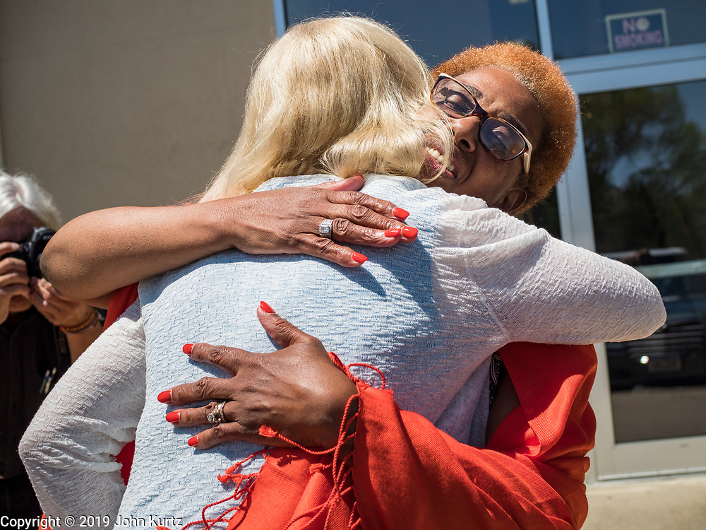 26 MAY 2019 - WATERLOO, IOWA: US Senator KIRSTEN GILLIBRAND (D-NY), left, hugs a church leader at Mt. Carmel Missionary Baptist Church in Waterloo. Sen. Gillibrand is on her 5th trip to Iowa this week to support her candidacy to be the Democratic nominee for the US Presidency. Iowa traditionally hosts the the first selection event of the presidential election cycle. The Iowa Caucuses will be on Feb. 3, 2020. Mt. Carmel Missionary Baptist Church was established in 1921 and is the third oldest African-American church in Waterloo. Waterloo has the largest African-American community in Iowa.             PHOTO BY JACK KURTZ