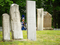Eddie Bird plays the echo of Taps during the Memorial Day service at Lang Cemetery in Meredith along the parade route from Main Street to Hesky Park Monday morning.  (Karen Bobotas/for the Laconia Daily Sun)