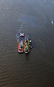 Nederland, Zuid-Holland, Gemeente Maassluis, 23-05-2011; Nieuwe Waterweg, baggerschip met lichter..A dregder dredging the Nieuwe Waterweg..luchtfoto (toeslag), aerial photo (additional fee required).copyright foto/photo Siebe Swart
