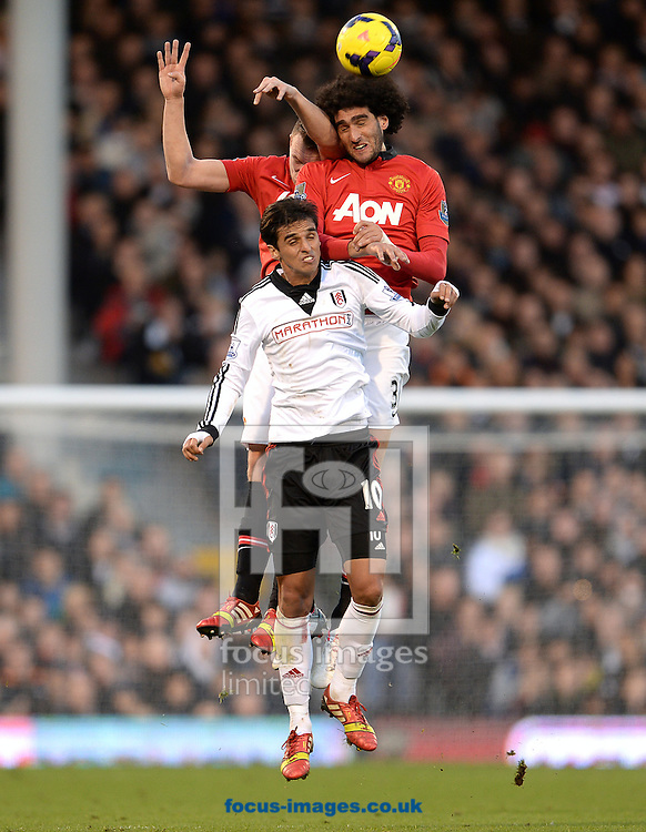 Picture by Andrew Timms/Focus Images Ltd +44 7917 236526<br /> 02/11/2013<br /> Bryan Ruiz of Fulham and Marouane Fellaini of Manchester United during the Barclays Premier League match at Craven Cottage, London.