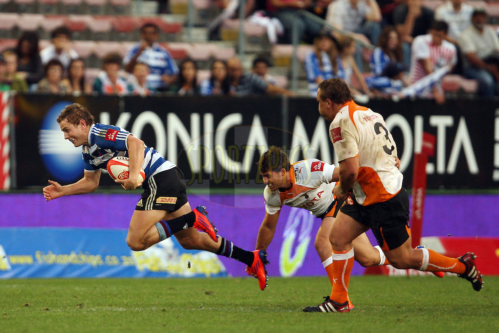 Johann Sadie of DHL WP is ankle-tapped during the Absa Currie Cup fixture between DHL Western Province and the Vodacom Cheetahs played at DHL Newlands in Cape Town, South Africa on 24 September. Photo by Jacques Rossouw/SPORTZPICS
