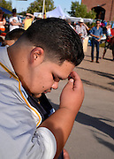 "Celebrants honor Saint John the Baptist, as one who brings seasonal monsoon rain to the desert, at the 16th annual El Dia De San Juan Fiesta at Mercado San Augustin on Monday, June 24, 2013, in Tucson, Arizona, USA. Che Marcello Vindiola, 20, who makes the sign of the cross, says that he participates in the fiesta to, ""cleanse myself for the monsoon."""