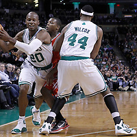 06 March 2012: Boston Celtics shooting guard Ray Allen (20) drives past Houston Rockets point guard Kyle Lowry (7) on a screen set by Boston Celtics power forward Chris Wilcox (44) during the Boston Celtics 97-92 (OT) victory over the Houston Rockets at the TD Garden, Boston, Massachusetts, USA.