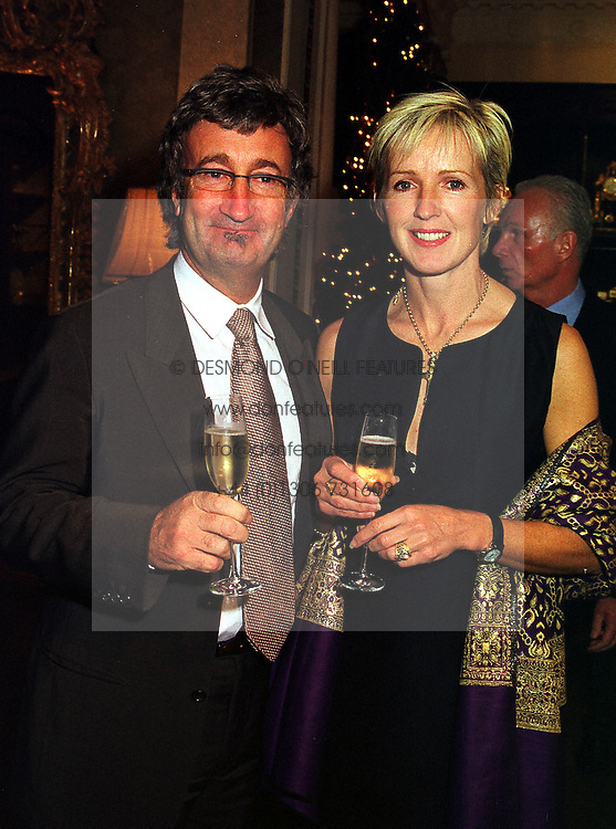 MR & MRS EDDIE JORDAN he owns the Formula 1 motor racing team Jordan, at a party in London on 1st December 1999.MZR 50