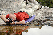 Solvin Zankl photographing the habitat for the Majorcan midwife toad (Alytes muletensis) Torrent de s'Esmorcador, Majorca, Spain. Solvin Zankl fotografirt in dem Tal Torrent de s' Esmorcador