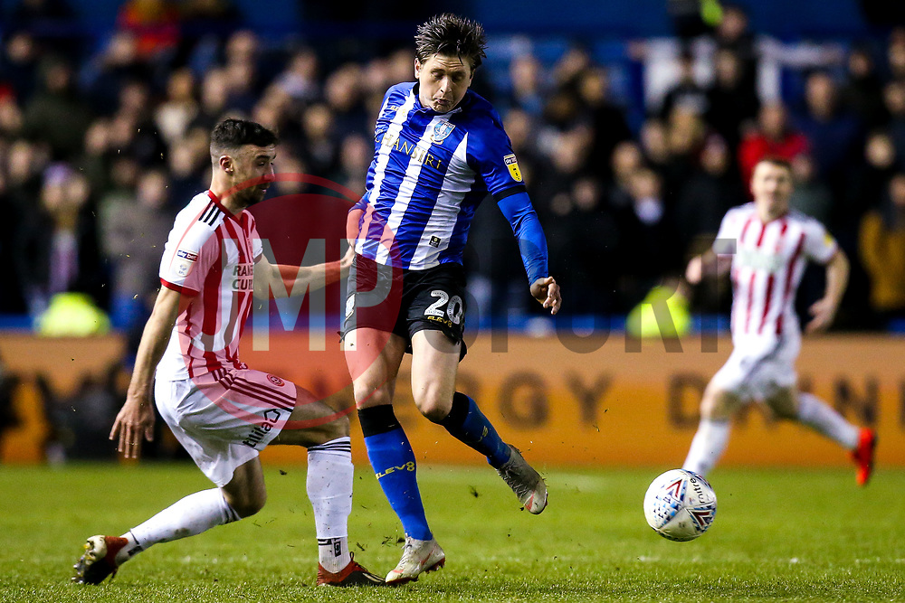 Adam Reach of Sheffield Wednesday takes on Enda Stevens of Sheffield United - Mandatory by-line: Robbie Stephenson/JMP - 04/03/2019 - FOOTBALL - Hillsborough - Sheffield, England - Sheffield Wednesday v Sheffield United - Sky Bet Championship