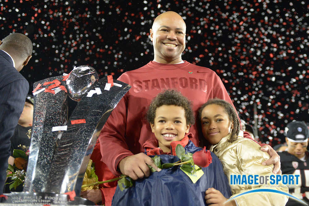 November 30, 2012; Stanford, CA, USA; Stanford Cardinal head coach David Shaw (center) poses for a photo with his children Carter Shaw (left) and Keegan Shaw (right) after the Pac-12 Championship game against the UCLA Bruins at Stanford Stadium. The Cardinal defeated the Bruins 27-24.