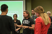 Daniel Johnsen, the facilitator of Startup Weekend Athens, talks to groups before they get into groups for an activity at the Ohio University Innovation Center on March 18, 2016.