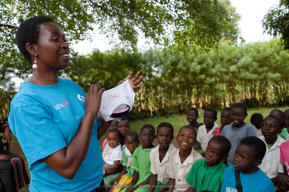 Lovisa Wankya, a teacher and an Afripads dealer, demonstrating the correct use of Afripads to students at Achilet Primary School near Tororo in Eastern Uganda on 1 August 2014. Afripads are reusable fibre sanitary pads that are having a revolutionary impact on menstrual hygiene management, particularly amongst girls and women who cannot afford expesive disposable pads, and who previously had to use rags, cotton wool or toilet paper.