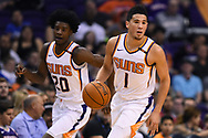 Oct 25, 2017; Phoenix, AZ, USA; Phoenix Suns guard Devin Booker (1) dribbles the ball up the court in front of forward Josh Jackson (20) during the game against the Utah Jazz at Talking Stick Resort Arena. Mandatory Credit: Jennifer Stewart-USA TODAY Sports