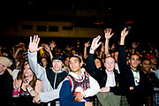 Crowds cheering with their arms in the air. UK B-Boy championships 06. 08/10/2006