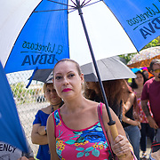 OCTOBER 20 - PONCE, PUERTO RICO - <br /> Sandra Santos, 37, a resident of Coto Laurel in Ponce, waits in a long line to receive donated water and MRE's in a distribution center in a sports arena in the Southern town of Ponce, the 2nd largest city in Puerto Rico. <br /> (Photo by Angel Valentin/Freelance)
