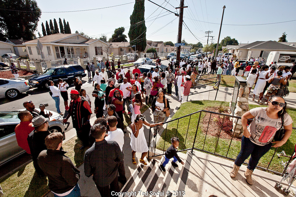Friends and family gather on 114th street outside the church.<br /> Funeral services for Kevin &quot;Flipside&quot; White at Macedonia Church in Watts.<br /> White was shot dead in what is believed to be an unprovoked attack during a gang conflict at Watts' Nickerson Gardens and Jordan Downs housing projects.<br /> Flipside, 44, was a founding member of Watts' first major label hip hop act, O.F.T.B. (Operation From The Bottom).