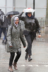 © Licensed to London News Pictures. 24/09/2019. London, UK. People are seen running for shelter during a heavy downpour in London. Photo credit: Dinendra Haria/LNP