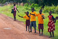 Passing school children on the road in Uganda.
