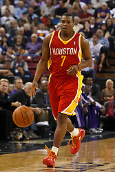 March 7, 2011; Sacramento, CA, USA;  Houston Rockets point guard Kyle Lowry (7) dribbles the ball against the Sacramento Kings during the first quarter at the Power Balance Pavilion. Houston defeated Sacramento 123-101.