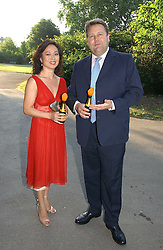 LORD STRATHCLYDE and MRS HENRY ANGUST at the Concervative Party Summer Party held in the gardnes of The Royal Hospital, Chelsea, London on 3rd July 2006.<br /><br />NON EXCLUSIVE - WORLD RIGHTS