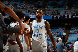 CHAPEL HILL, NC - FEBRUARY 05: Seventh Woods #0 of the North Carolina Tar Heels shakes hands during a game against the North Carolina State Wolfpack on February 05, 2019 at the Dean Smith Center in Chapel Hill, North Carolina. North Carolina won 113-96. North Carolina wore retro uniforms to honor the 50th anniversary of the 1967-69 team. (Photo by Peyton Williams/UNC/Getty Images) *** Local Caption *** Seventh Woods