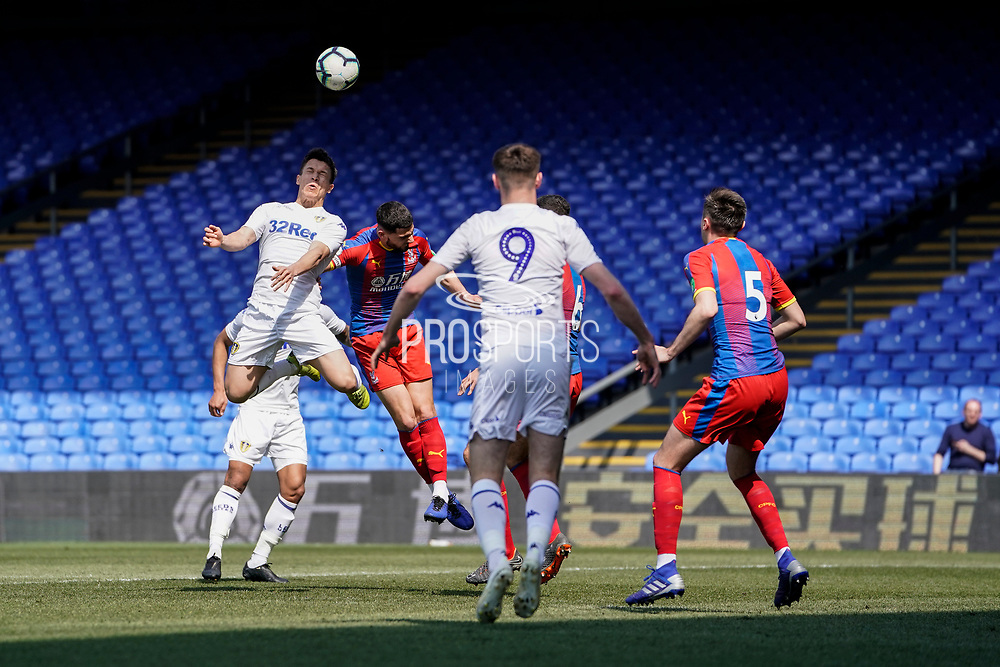 Kun Temenuzhkov of Leeds United U23 heads the ball under pressure during the U23 Professional Development League match between U23 Crystal Palace and Leeds United at Selhurst Park, London, England on 15 April 2019.