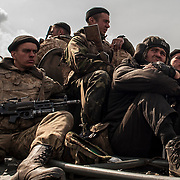 A column of Ukrainian military men riding on armoured personnel carriers and tanks are blocked by pro-Russia activists in the eastern Ukrainian city of Kramatorsk, in the Donetsk region.