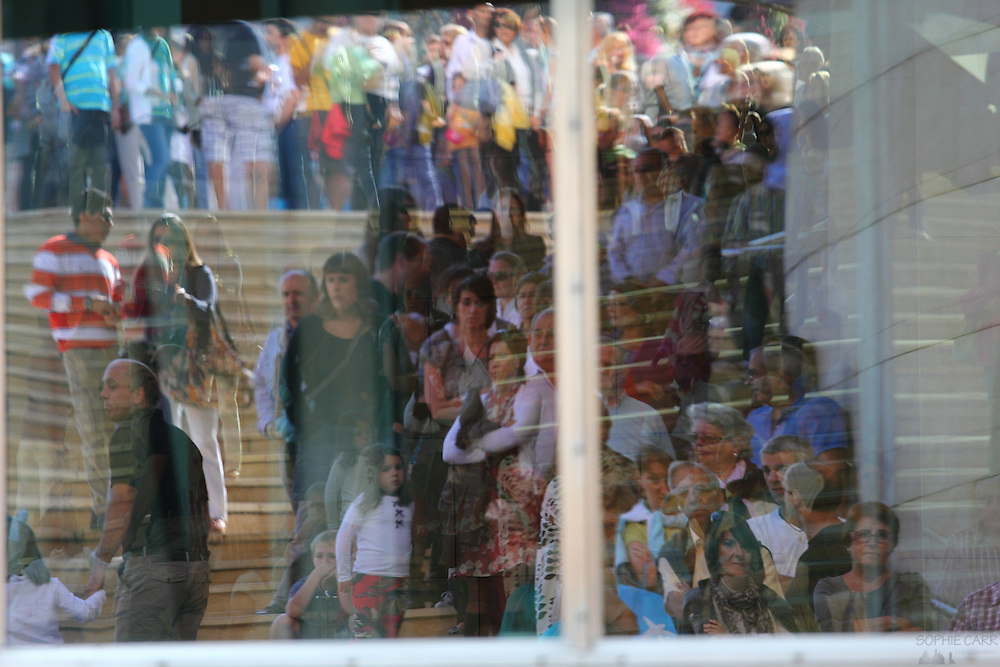 Reflections of the crowds lined up to get into the Guggenheim on its anniversary (as it was free)