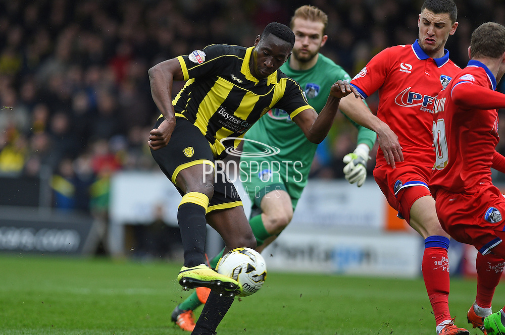 Burton Albion forward Lucas Akins takes a shot at goal at Oldham Athletic goalkeeper Joel Coleman looks on during the Sky Bet League 1 match between Burton Albion and Oldham Athletic at the Pirelli Stadium, Burton upon Trent, England on 26 March 2016. Photo by Jon Hobley.