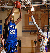 12 JAN. 2010 -- BRENTWOOD, Mo. -- Maplewood / Richmond Heights High School basketball player Calvin Belts (32) battles Brentwood's Dejuan Fuller (42, CQ) for a rebound during the neighborhood game Tuesday, Jan. 12, 2009 at Brentwood High School in Brentwood, Mo. Photo (c) copyright 2010 by Sid Hastings.