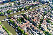 Nederland, Noord-Holland, Amsterdam, 29-06-2018; centrum van de stad, Nieuwmarktbuurt, met diagonaal Recht Boomssloot, richting Oude Schans, Krom Boomssloot (rechts). Montelbaanstoren, Oude Waal. Montelbaanstraat.<br /> City centre, Nieuwmarkt quarter.<br /> <br /> luchtfoto (toeslag op standard tarieven);<br /> aerial photo (additional fee required);<br /> copyright foto/photo Siebe Swart