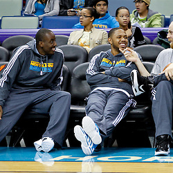 December 17, 2011; New Orleans, LA, USA; New Orleans Hornets players Al-Farouq Aminu, Eric Gordon and Chris Kaman watch from the bench during a scrimmage at the New Orleans Arena.   Mandatory Credit: Derick E. Hingle-US PRESSWIRE